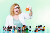 Chemist woman with chemical glassware flask — Stock Photo