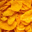 Closeup of corn flakes breakfast morning meal as food background — Stock Photo