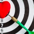 Stock Photo: Black white target with dart in heart love symbol as bullseye