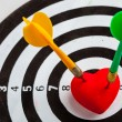 Black white target with two darts in heart love symbol as bullseye — Stock Photo #38638483