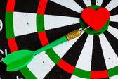 Black white target with dart in heart love symbol as bullseye — Stock Photo
