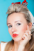 Portrait beautiful woman pinup girl retro style blowing a kiss - flirty on blue — Stock Photo
