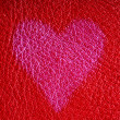 Valentine's day card. Heart love symbol on red leather background — Stockfoto #39215309