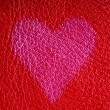 Valentine's day card. Heart love symbol on red leather background — Stockfoto