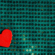 Valentines day background. Red heart on green fabric material — Stock Photo #39215639