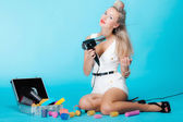 Sexy girl retro style in curlers with hairdryer styling hair — Stock Photo
