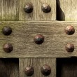 Old wooden background with metal rivets vintage door detail — Stock Photo