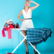 Stock Photo: Sexy girl retro style ironing male shirt, womhousewife in domestic role.