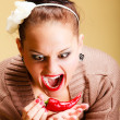 Face expression woman sexy girl biting spicy hot red cayenne chilli pepper — Stock Photo
