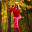 Healthy lifestyle. Fitness girl doing exercise outdoor — Stock Photo #39289327