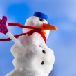 Little happy christmas snowman with pink gloves outdoor. Winter season. — Stock Photo #39289733