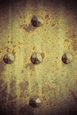 Brown grunge metal plate or armour texture with rivets — Stock Photo