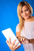 Woman girl using tablet touchpad reading e-book e-reader on blue — Stock Photo