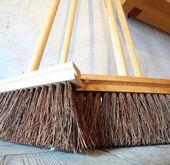 Large brooms on wooden floor housework — Stock Photo
