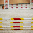 Yellow red white obstacle for jumping horses. Riding competition. — Stock Photo #39350257