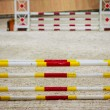 Yellow red white obstacle for jumping horses. Riding competition. — Stock Photo