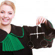 Female lawyer attorney in classic polish black green gown and scales — Zdjęcie stockowe