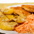Stock Photo: Dinner meal. Fried chicken roasted potatos and carrot salad.