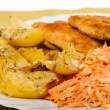 Dinner meal. Fried chicken roasted potatos and carrot salad. — Stock Photo
