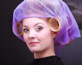 Portrait beautiful blond girl hair curlers rollers hairdresser beauty salon — Stockfoto