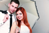 Happy married couple bride groom on gray background — Stock Photo