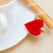 White cup coffe waffle roll with cream heart. Love valentine's day — Stock Photo