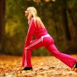 Stock Photo: Healthy lifestyle. Fitness girl doing exercise outdoor