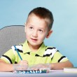 Young cute boy draws with color pencils — Stock Photo #39529191