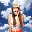 Surprised emotional girl talking on mobile phone. Sky background. — Stock Photo