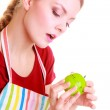 Housewife or chef in kitchen apron using apple timer isolated — Stock Photo