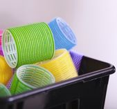 Colorful hair rollers curlers in basket. Hairdressing beauty salon. — Stock Photo