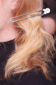 Female blond hair with hairpin pin. Woman by hairdresser in beauty salon — Stock Photo