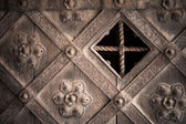 Architectural detail. Part decorative old wooden door with ornament — Stock Photo