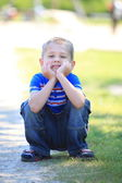 Thoughtful boy in park — Stock Photo