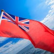 UK ensign british maritime flag of yacht sailboat blue sky sea. Sailing. — Stock Photo