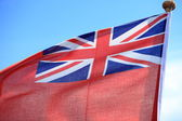 British maritime red ensign flag blue sky — 图库照片