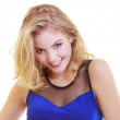Portrait of beautiful blond girl in sexy deep blue dress isolated — Stock Photo #39658617