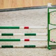 Stock Photo: Green red white obstacle for jumping horses. Riding competition.