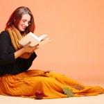 Autumn fashion girl with book orange eye-lashes — Stock Photo