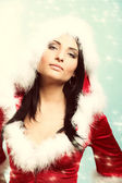 Beautiful sexy girl wearing santa claus clothes winter snow background — Stock Photo