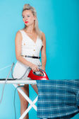 Sexy girl retro style ironing male shirt, woman housewife in domestic role. — Stock Photo