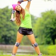 Woman roller skating sport activity in park — Stock Photo #39877357