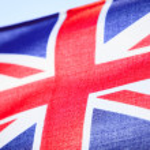 Closeup of UK ensign british flag. Symbol of european country. — Stock Photo #39877369