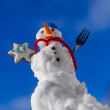 Little happy christmas snowman with cookie star outdoor. Winter season. — Stock Photo #39877553