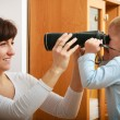Boy child kid son with camera taking photo his mother. At home. — Stock Photo