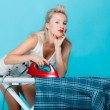 Sexy girl retro style ironing male shirt, woman housewife in domestic role. — Stock Photo #39878027