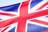 Closeup of UK ensign british flag. Symbol of european country. — Stock Photo