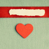Valentines day background. paper blank heart on green fabric material — Stock Photo