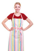 Young housewife or barista wearing kitchen apron isolated — Stock Photo
