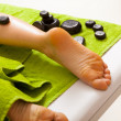Spa salon. Female legs having hot stone massage. Bodycare and relax. — Stock Photo